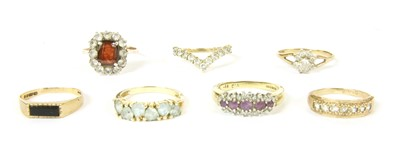 Lot 2-A collection of seven gold and stone set rings