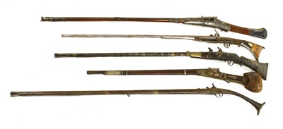 553 - Five South Indian or Sri Lankan flintlock long guns,