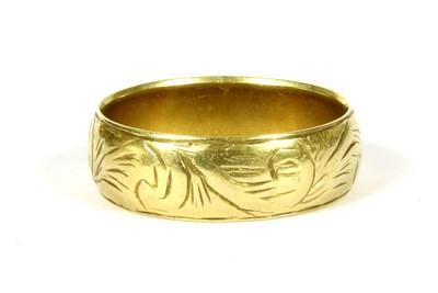 Lot 9-An 18ct gold wedding band