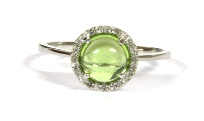 Lot 12A-A white gold cabochon peridot and diamond circular cluster ring