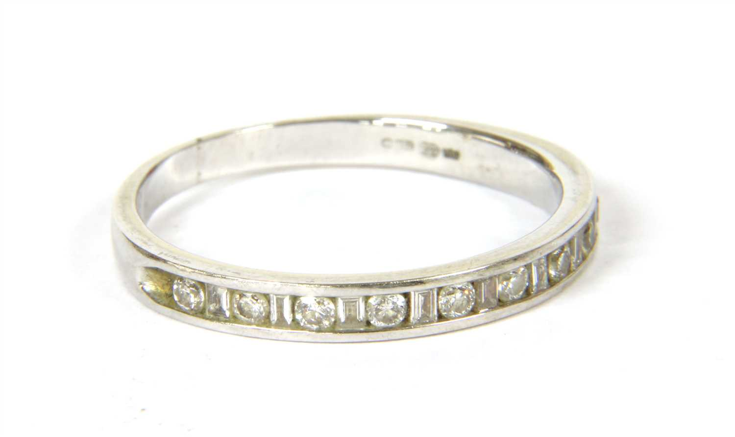 Lot 15-An 18ct white gold diamond set half eternity ring