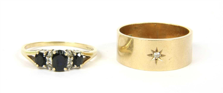 Lot 18-A 9ct gold diamond set wedding ring
