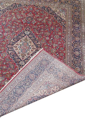 Lot 217 - A Kashan carpet