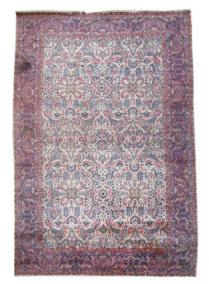 Lot 243 - A large Kirman carpet