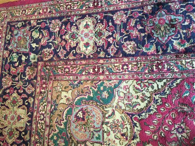 Lot 7-A large Kashan carpet