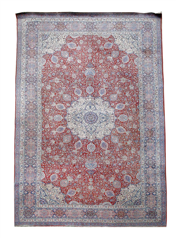 Lot 145 - A large Tabriz carpet