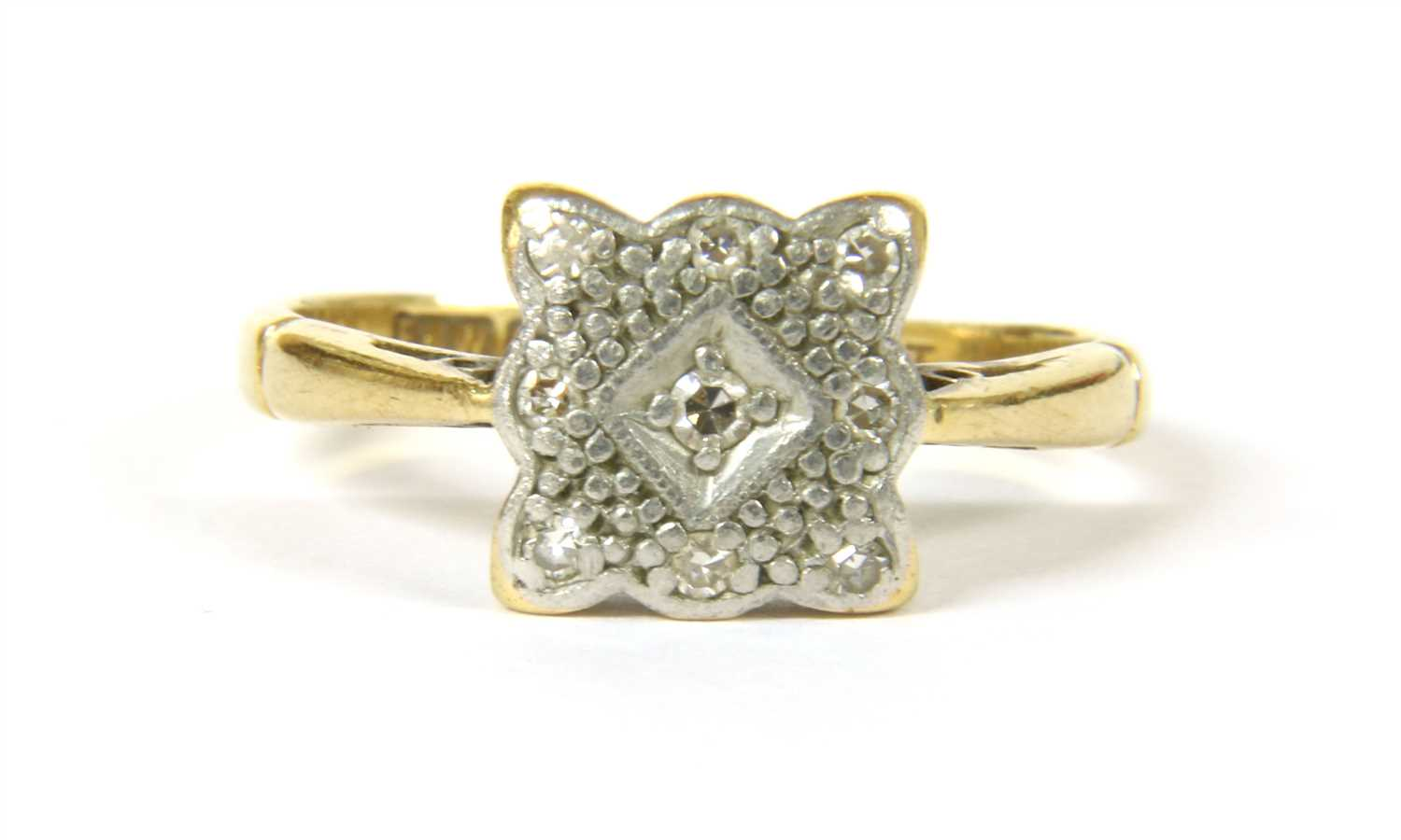 Lot 2-An 18ct gold Art Deco diamond set square cluster ring