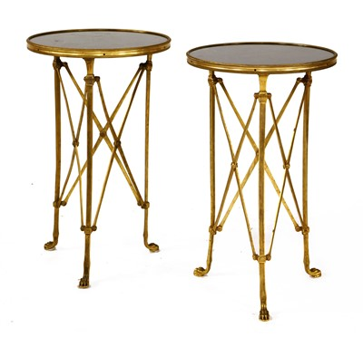 Lot 30-A pair of Regency-style gilt metal occasional tables