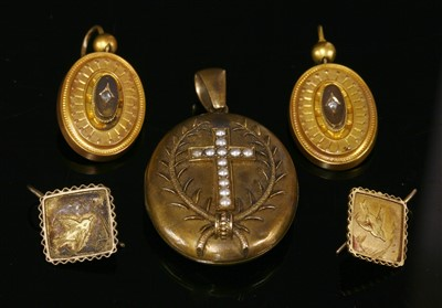 Lot 34-A Victorian gold oval hinged locket