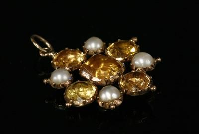 Lot 7 - A Georgian gold topaz, split pearl and paste pendant