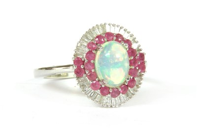 Lot 24-A white gold opal, ruby and diamond oval cluster ring