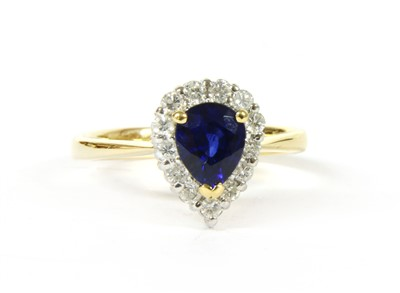 Lot 25-A sapphire and diamond pear shaped cluster ring