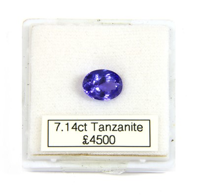 Lot 4-An unmounted oval mixed cut tanzanite
