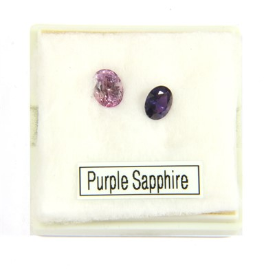 Lot 8-Two unmounted oval mixed cut sapphires