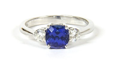 Lot 11-An 18ct white gold three stone tanzanite and diamond ring