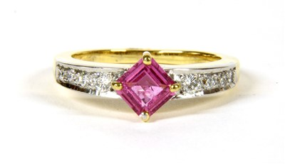 Lot 13-An 18ct two colour gold pink sapphire and diamond ring