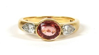 Lot 21-An 18ct rose gold and white gold single stone orange sapphire ring