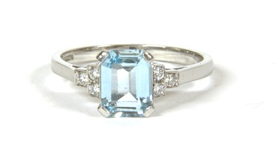 Lot 14-An 18ct white gold single stone aquamarine ring