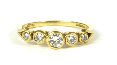 Lot 23-An 18ct gold five stone diamond ring