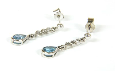 Lot 18-A pair of white gold  blue topaz and diamond earrings