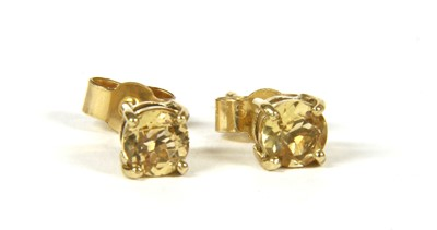 Lot 24-A pair of gold single stone topaz stud earrings