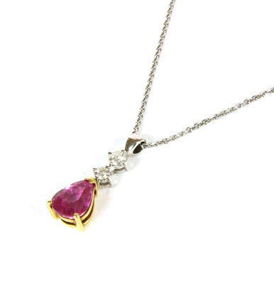 Lot 22-An 18ct two colour gold pink sapphire and diamond pendant