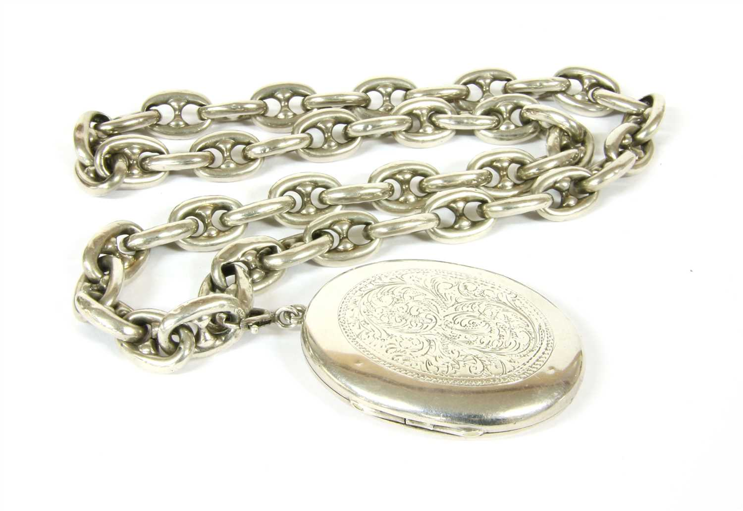 A Victorian silver hinged locket,