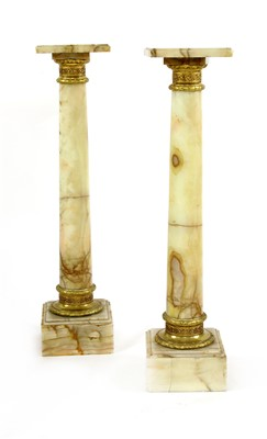 Lot 14-A pair of alabaster columns