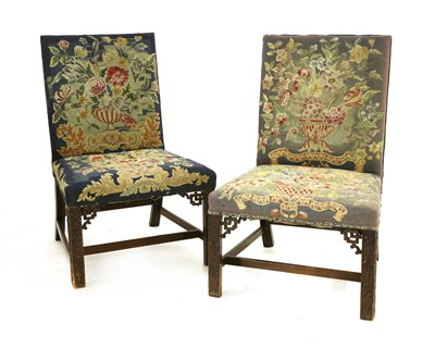 Lot 11-A pair of Chippendale period single library chairs