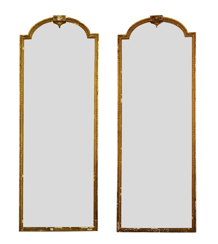 A pair of gilt gesso pier mirrors,