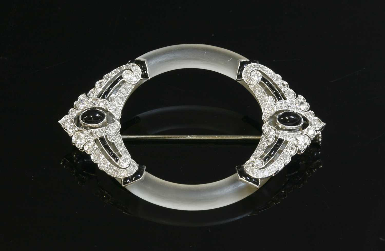 Lot 198 - A French Art Deco platinum, gold, rock crystal, onyx and diamond brooch, c.1925