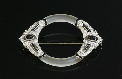 Lot 131 - A French Art Deco platinum, gold, rock crystal, onyx and diamond brooch, c.1925