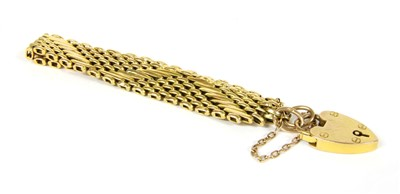 Lot 6-An Edwardian gold gate style bracelet
