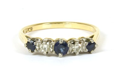 Lot 23-A graduated five stone sapphire and diamond ring