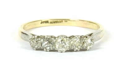Lot 7-A graduated five stone diamond ring with Swiss cut diamonds