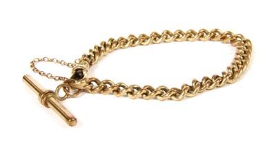 Lot 21-A 9ct gold curb bracelet