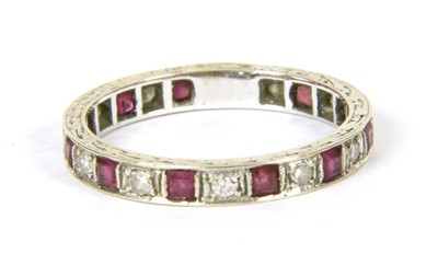 Lot 12-A white gold ruby and diamond eternity ring