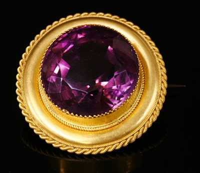 Lot 39-A Victorian gold shield form single stone amethyst brooch