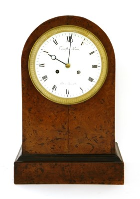 Lot 24-A French amboyna mantel clock