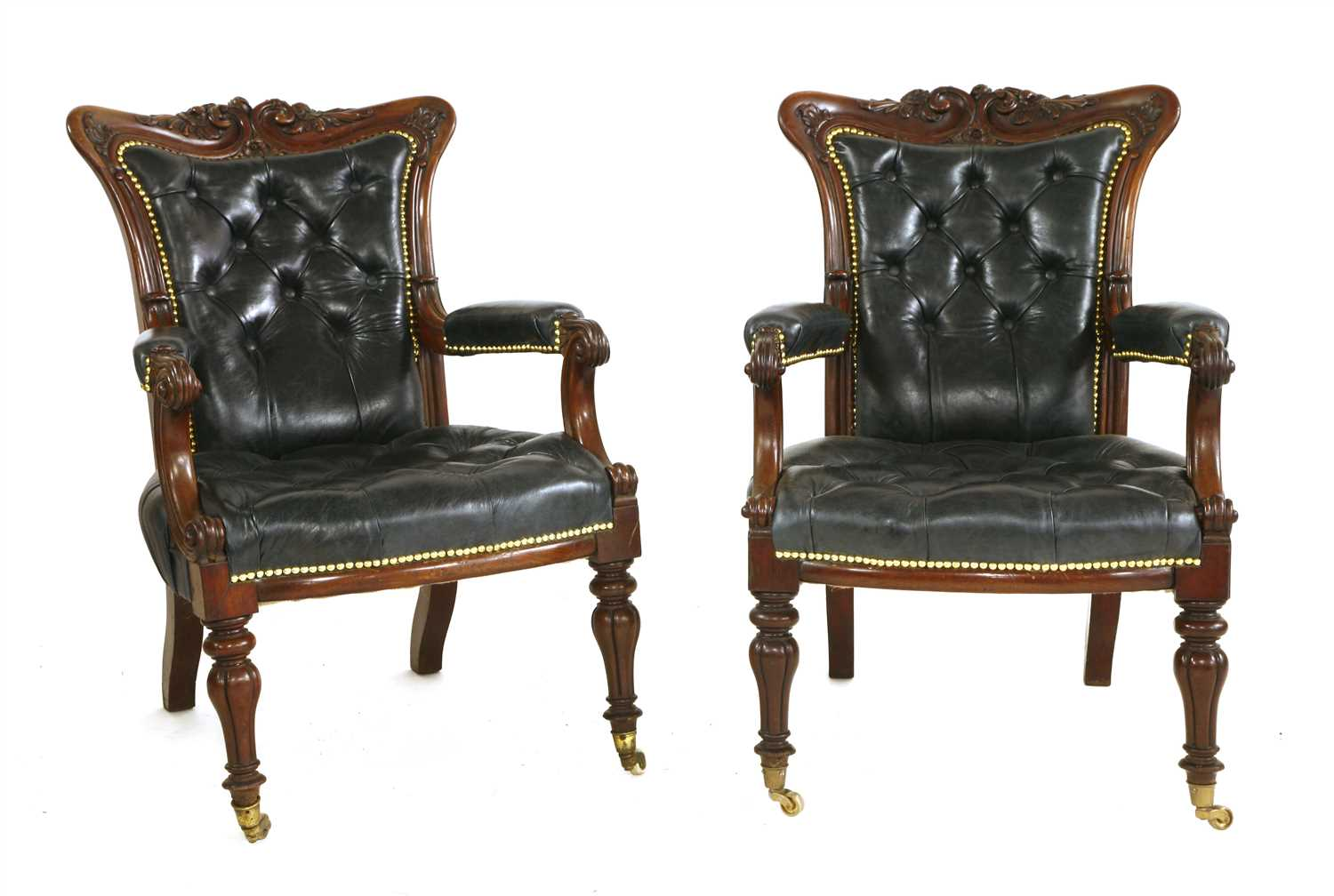 143 - A pair of mahogany library armchairs,