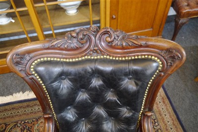 Lot 143-A pair of mahogany library armchairs
