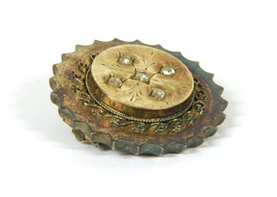 Lot 5-A Victorian gold circular shield brooch form brooch
