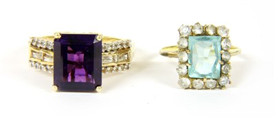 Lot 19-A gold rectangular blue and white paste cluster ring