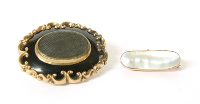 Lot 13-A Victorian gold and black enamel memorial brooch