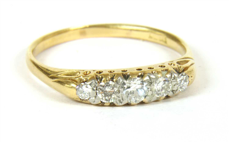 Lot 11-A five stone diamond ring