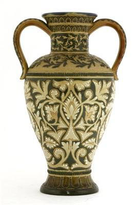 Lot 59 - A Doulton Lambeth stoneware twin-handled vase