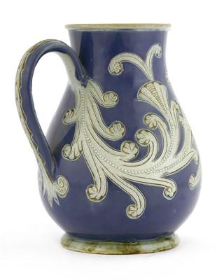 Lot 60 - A Doulton Lambeth stoneware jug