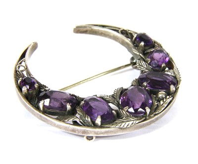Lot 24-A silver Arts and Crafts amethyst crescent brooch