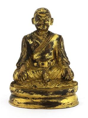 Lot 344 - A Tibetan bronze figure