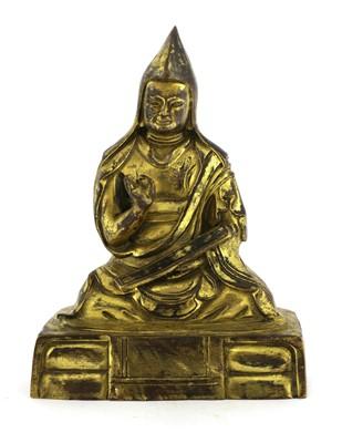 Lot 340 - A Tibetan bronze lama